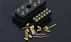 Springs for electronic connectors